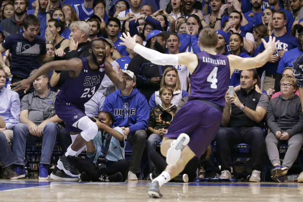 Stephen F. Austin forward Nathan Bain, left, and guard David Kachelries (4) celebrate Bain's game winning basket against Duke in overtime in Durham, N.C.