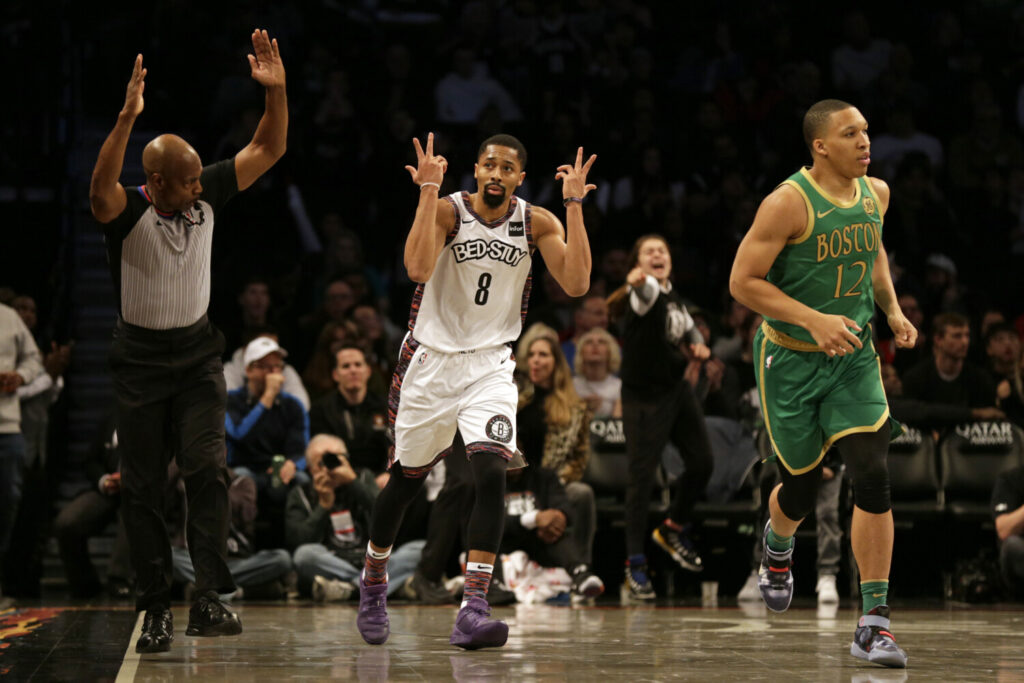 Guard Spencer Dinwiddie had 32 points and 11 assists as the Nets beat the Celtics 112-107 on Friday in New York.