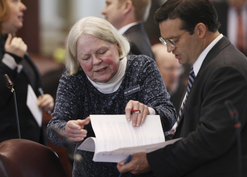 Rep. Ann Peoples, D-Westbrook, left, speaks with then House Majority Leader Seth Berry, D-Bowdoinham, in 2013 at the State House in Augusta.