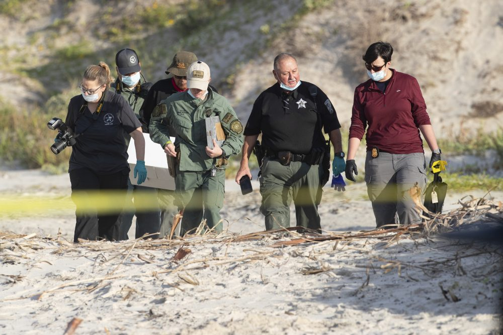 Officials in Texas are looking for a man and a woman who may have had contact with a New Hampshire couple whose bodies were found buried at a Corpus Christi beach, above, last month.