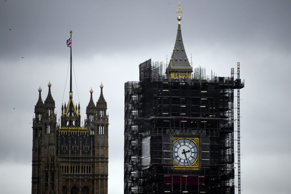 """A view of the Victoria Tower, left, and the Elizabeth Tower, which holds the bell known as """"Big Ben"""", in London, Friday, Nov. 1, 2019."""
