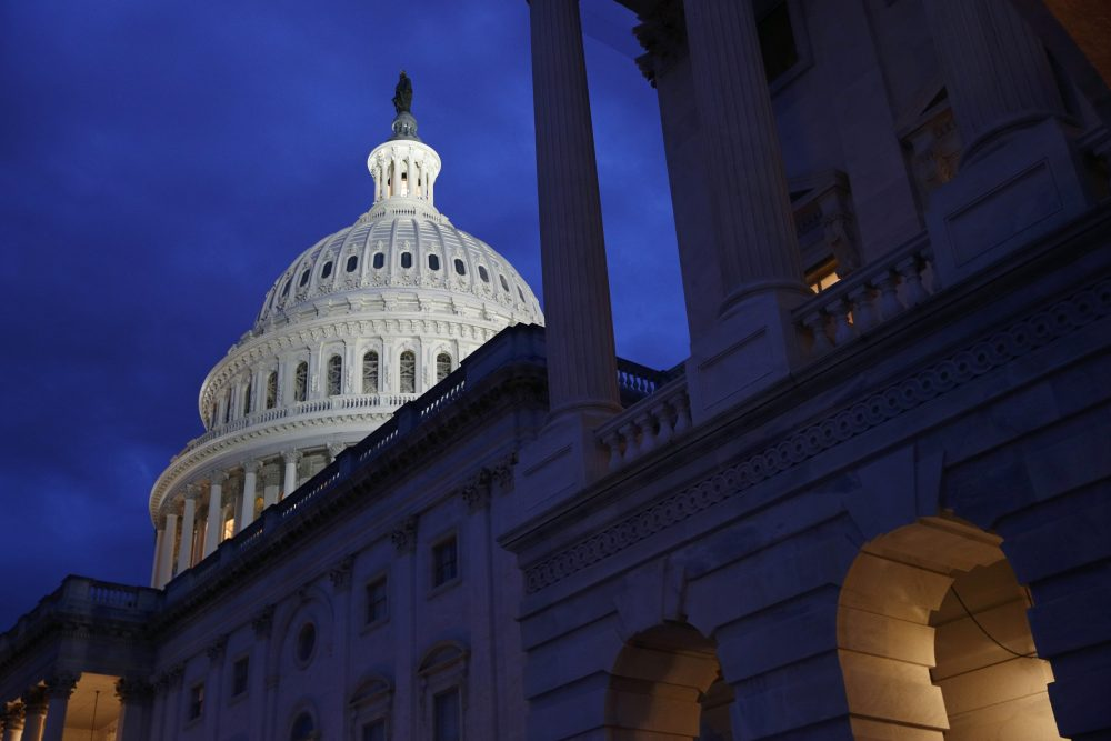 An annual congressional report says the U.S. budget deficit is likely to burst through the symbolic $1 trillion barrier this year despite a healthy economy.