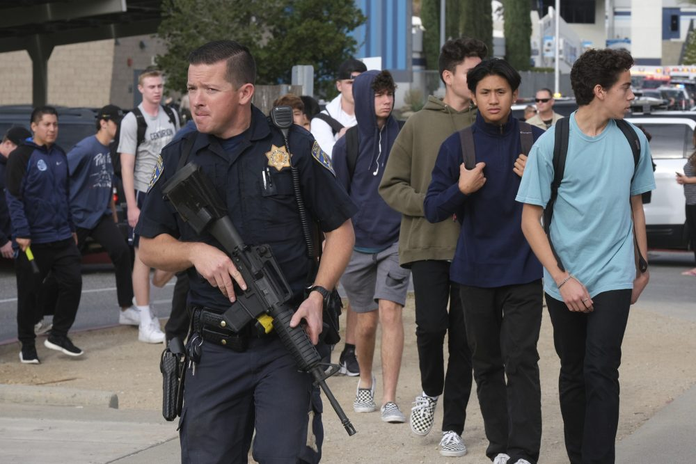 Students are escorted off campus following a shooting at Saugus High School on Thursday in Santa Clarita, Calif.