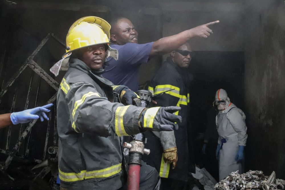 Rescuers attend the scene of an aircraft operated by private carrier Busy Bee which crashed in Goma, Congo on Sunday. The plane carrying at least 17 passengers crashed Sunday on takeoff.