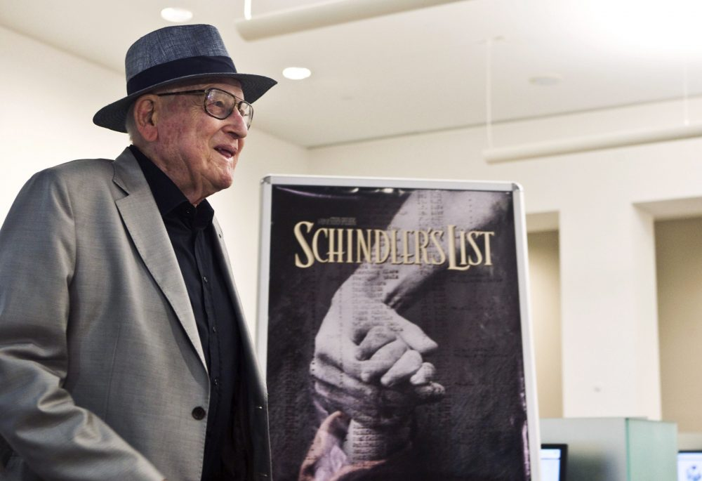 In this Wednesday, July 22, 2015 file photo, Branko Lustig stands next to a poster of the film Schindler's List at Yad Vashem Holocaust memorial in Jerusalem.