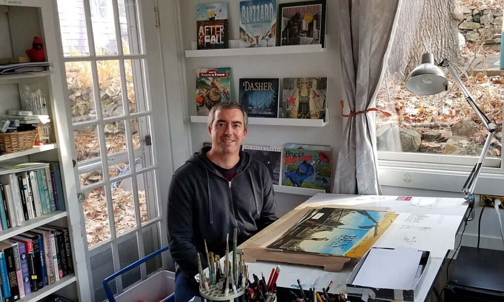 Matt Tavares, children's book author and illustrator, at his drafting table in his home in Ogunquit.