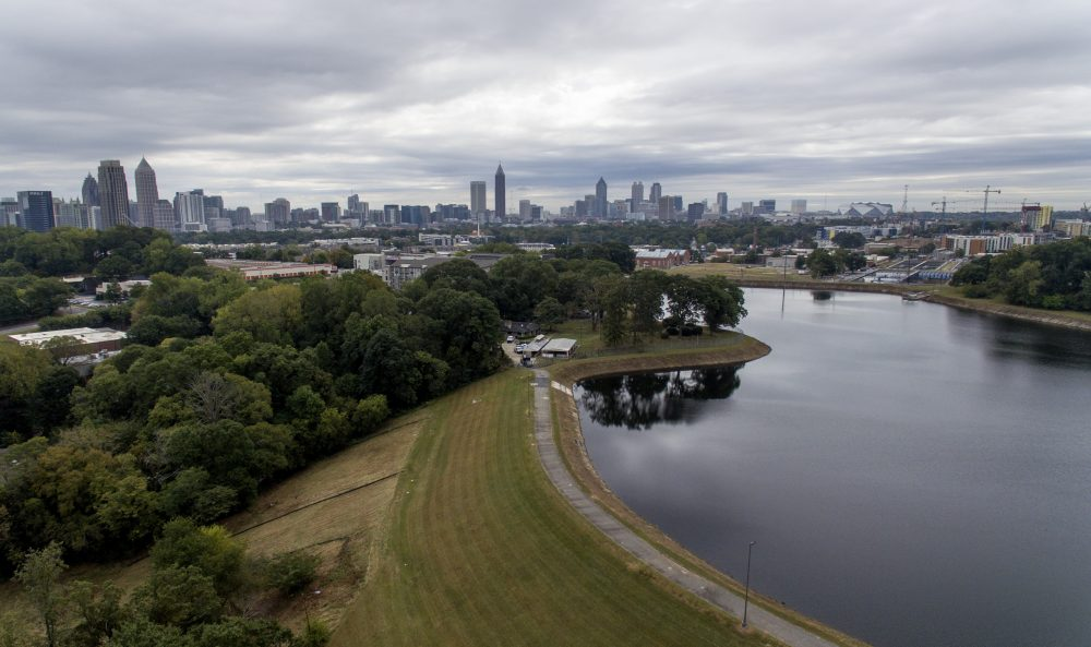 Reservoir No. 1, a 180 million-gallon water supply that has been out of service much of the past few decades, sits against the backdrop of the city skyline Oct. 15 in Atlanta. The city made repairs and brought it back online in 2017, only to shut it down again after water leaks were noticed near businesses located beneath the dam. Were the dam to catastrophically fail, the water could inundate more than 1,000 single-family homes, dozens of businesses, a railroad and a portion of Interstate 75, according to an emergency action plan.