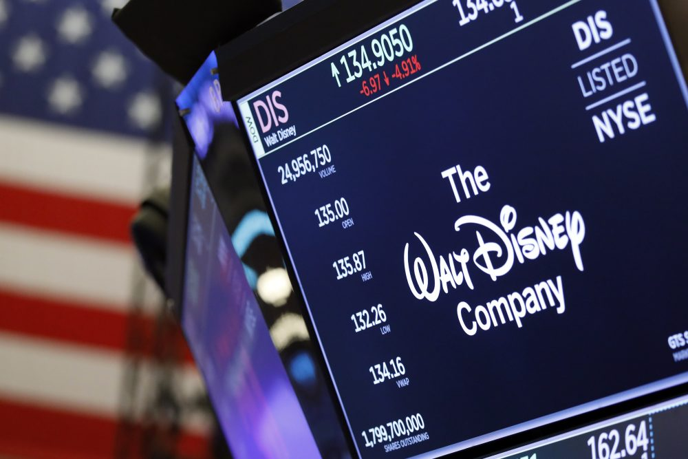 In this Aug. 7, 2019, file photo the logo for The Walt Disney Company appears above a trading post on the floor of the New York Stock Exchange. On Tuesday, Nov. 12, Disney Plus launched its streaming service.