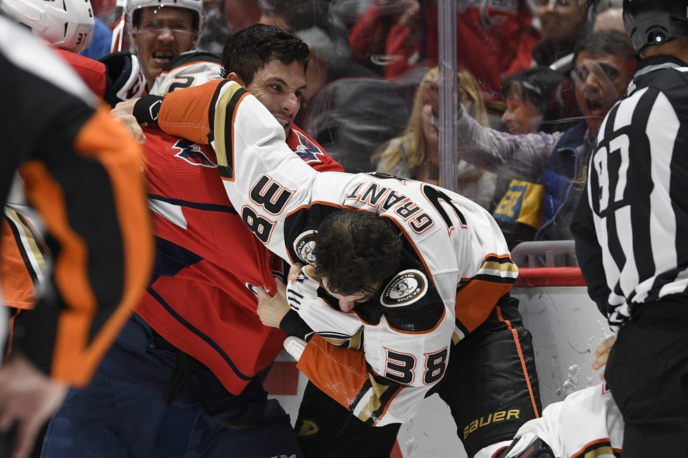 Washington Capitals right wing Garnet Hathaway, left, fights Anaheim Ducks center Derek Grant during the second period Monday in Washington. Hathaway, a Kennebunkport native, was ejected for spitting at Anaheim's Erik Gudbranson.