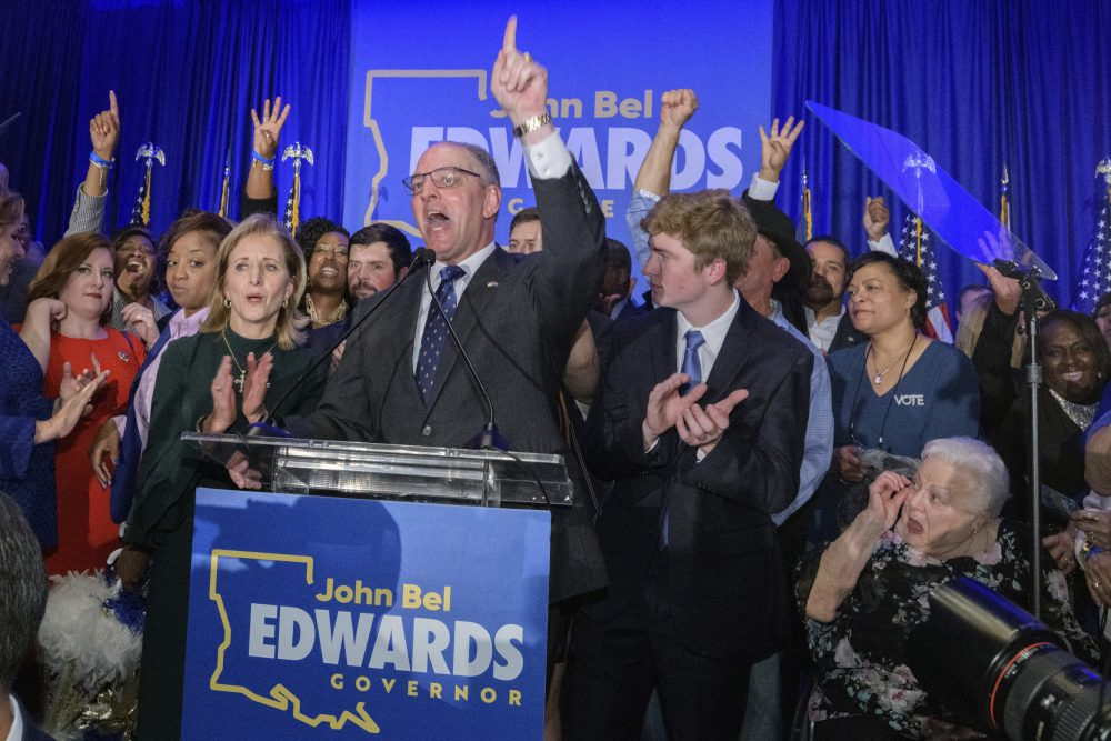 Louisiana Gov. John Bel Edwards arrives to address supporters at his election night watch party in Baton Rouge, La., on Saturday night.