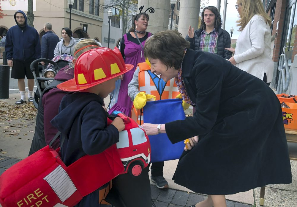 Sen. Susan Collins, R-Maine, hands out candy to children outside her office during an Oct. 25 trick-or-treat event hosted by the local chamber of commerce in Lewiston. Associated Press/David Sharp