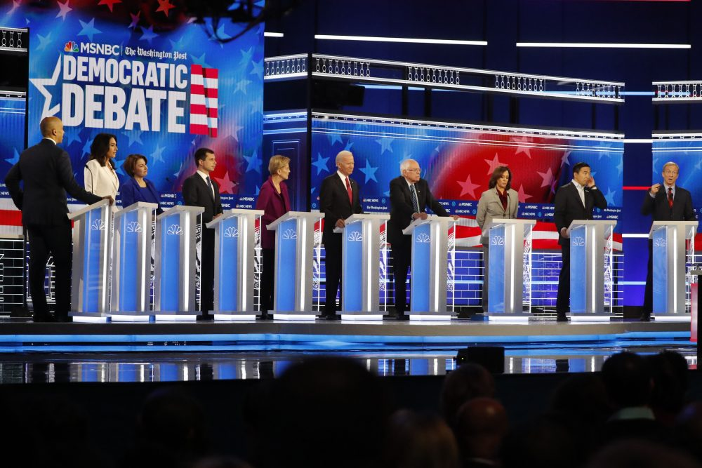 Democratic presidential candidates from left, Sen. Cory Booker, D-N.J., Rep. Tulsi Gabbard, D-Hawaii, Sen. Amy Klobuchar, D-Minn., South Bend, Ind., Mayor Pete Buttigieg, Sen. Elizabeth Warren, D-Mass., former Vice President Joe Biden, Sen. Bernie Sanders, I-Vt., Sen. Kamala Harris, D-Calif., former technology executive Andrew Yang and investor Tom Steyer participate in a Democratic presidential primary debate on Wednesday in Atlanta.
