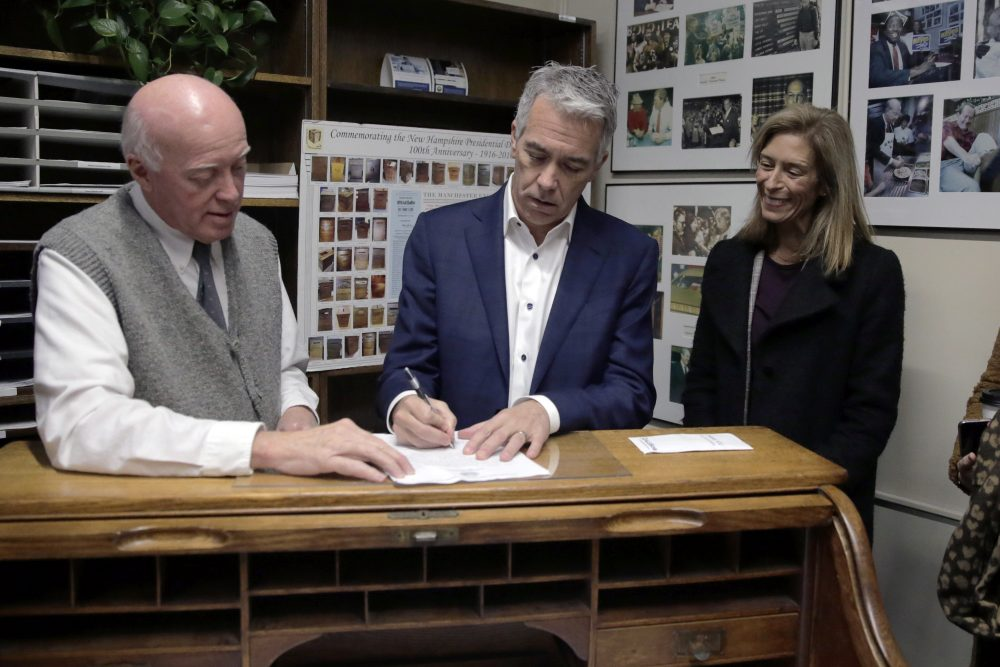 Republican presidential candidate former U.S. Rep. Joe Walsh, R-Ill., files to have his name listed on the New Hampshire primary ballot, Thursday, Nov. 14, 2019, in Concord, N.H. At left is New Hampshire Secretary of State Bill Gardner and at right is his wife Helene Walsh.