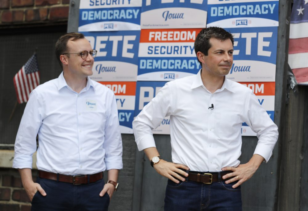 Then-Democratic presidential candidate Pete Buttigieg stands with his husband Chasten, left, before speaking at the Carroll County Democrats Fourth of July Barbecue in Carroll, Iowa, on July 4, 2019.