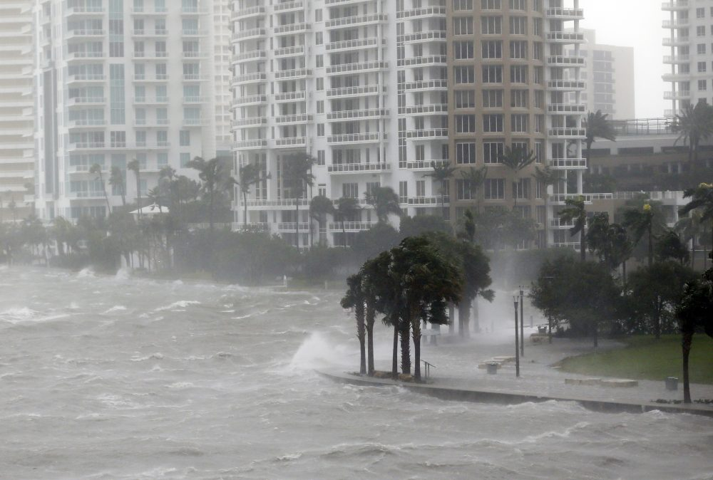 In this Sept. 10, 2017 file photo, waves crash over a seawall at the mouth of the Miami River from Biscayne Bay, Fla., as Hurricane Irma passes by in Miami.