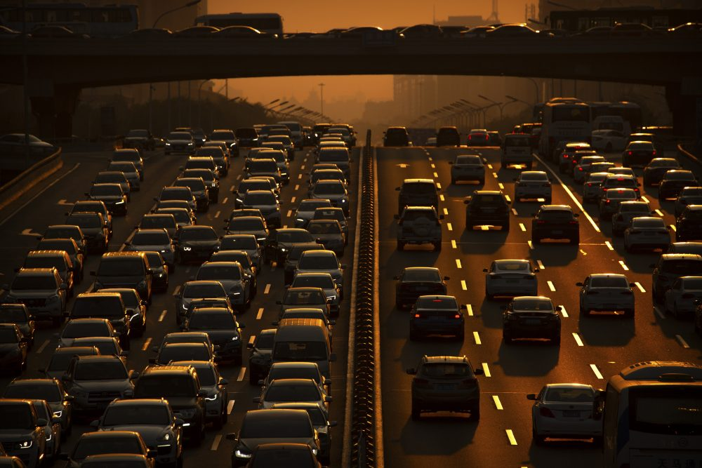 Commuters make their way along an expressway during rush hour in Beijing.