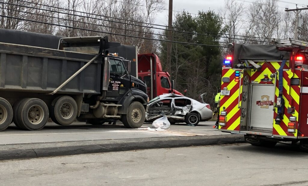 Emergency crews respond Monday morning to a crash between a dump truck and sedan on Riverside Drive in Augusta.
