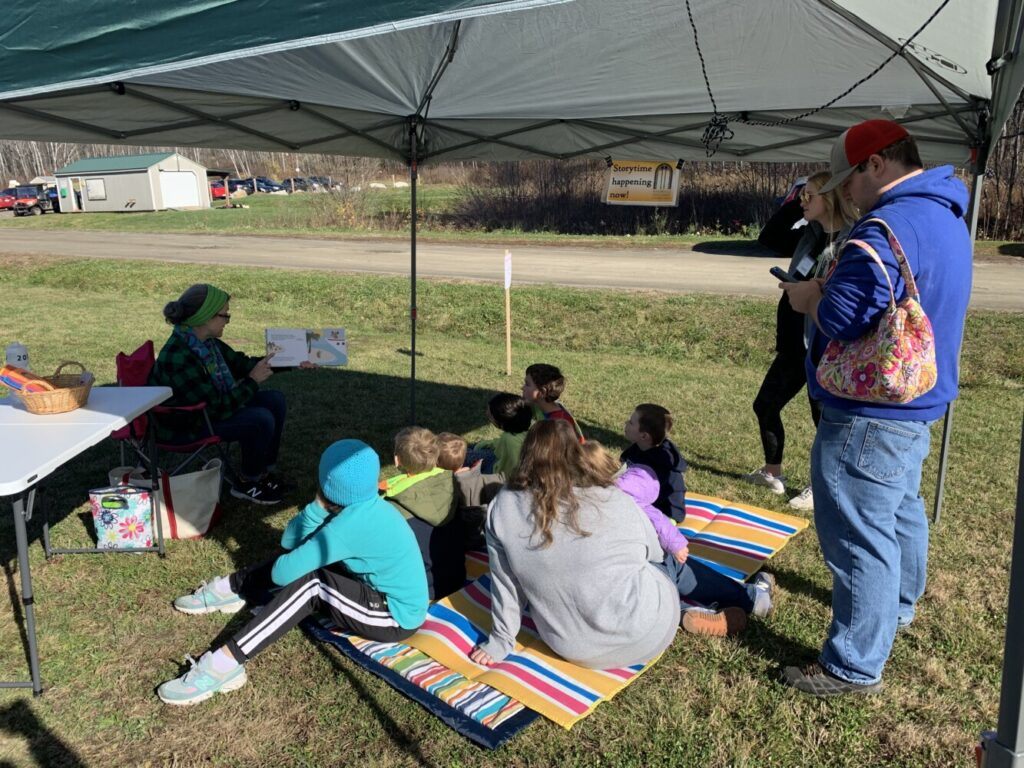 "Liz Davis, Waterville Public Library's children's librarian reads ""This Tree Counts"" to young children Saturday during the Quarry Road Trails Fall Festival in Waterville."