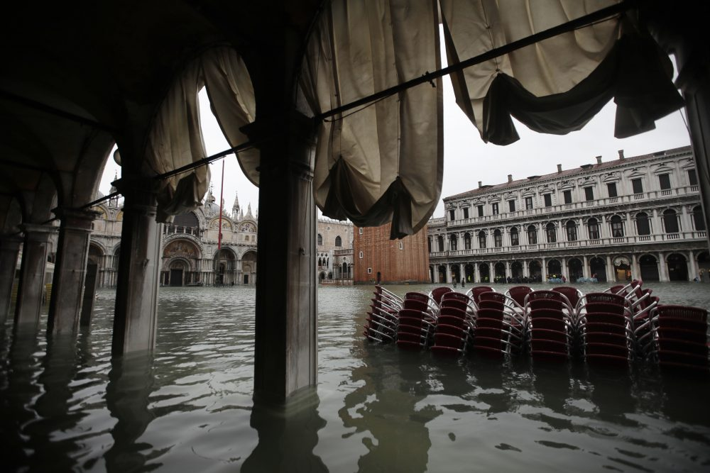 Chairs are piled up in the water in a flooded St. Mark's Square in Venice, Italy, Friday.