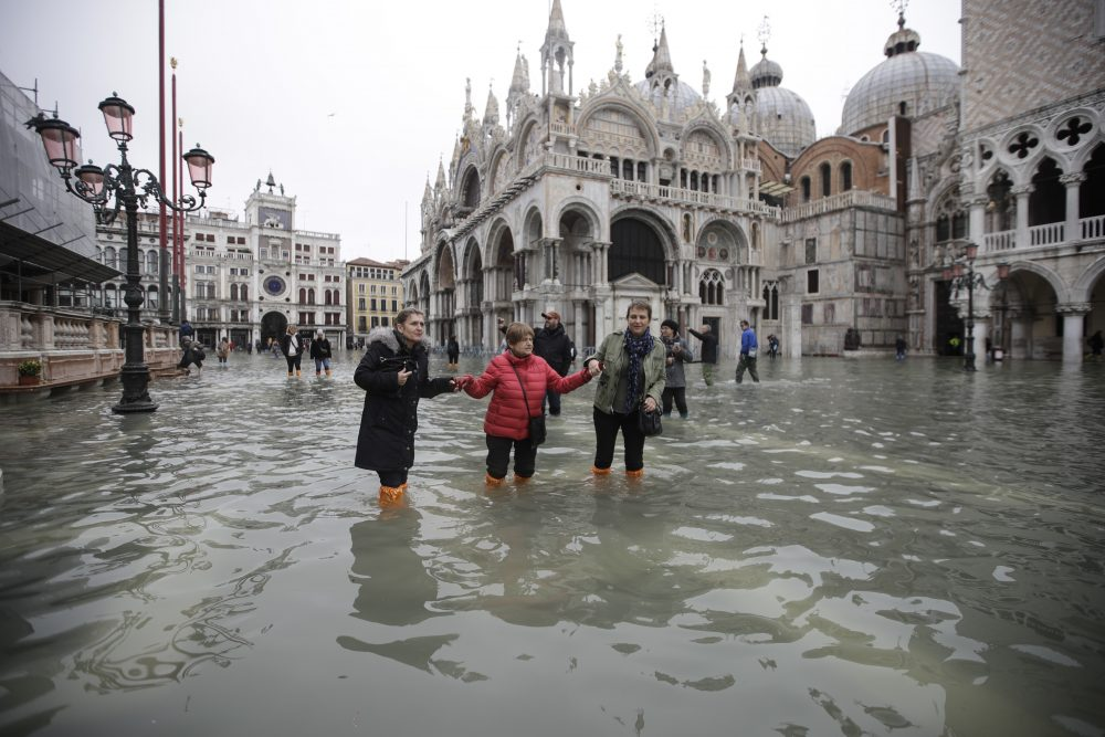 People wade through water in a flooded St. Mark's Square in Venice on Wednesday.