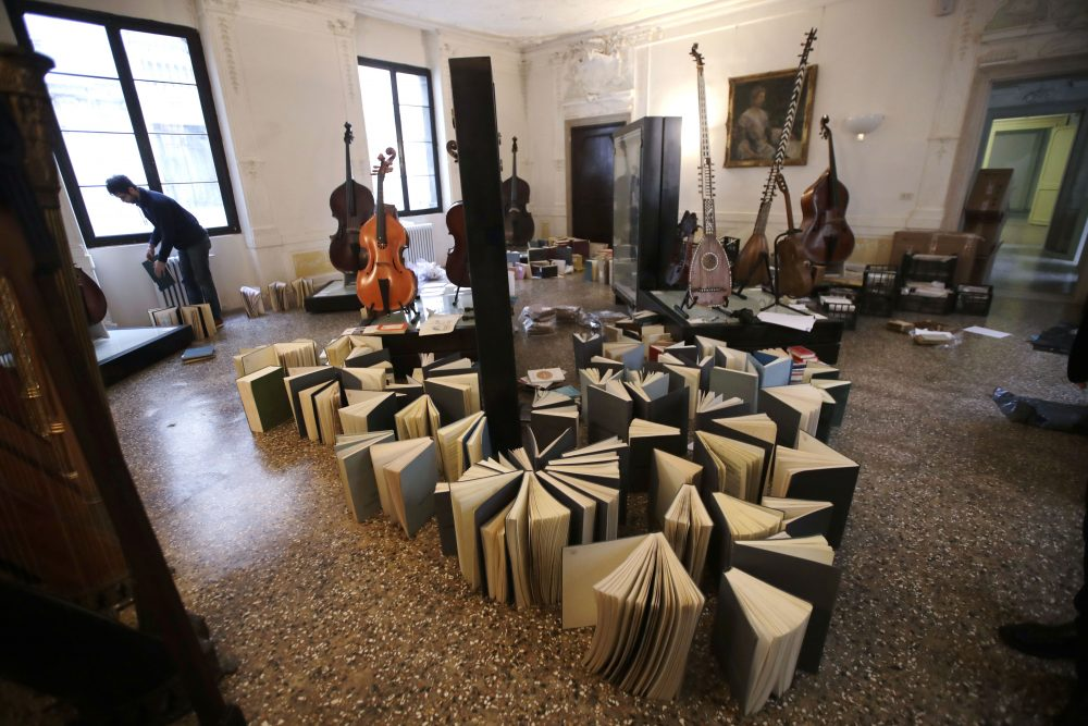 Volunteers try to save ancient music books by placing them to dry at the first floor of Venice Conservatory on Saturday after recovering them from ground floor. High tidal waters returned to Venice on Saturday, four days after the city experienced its worst flooding in 50 years.