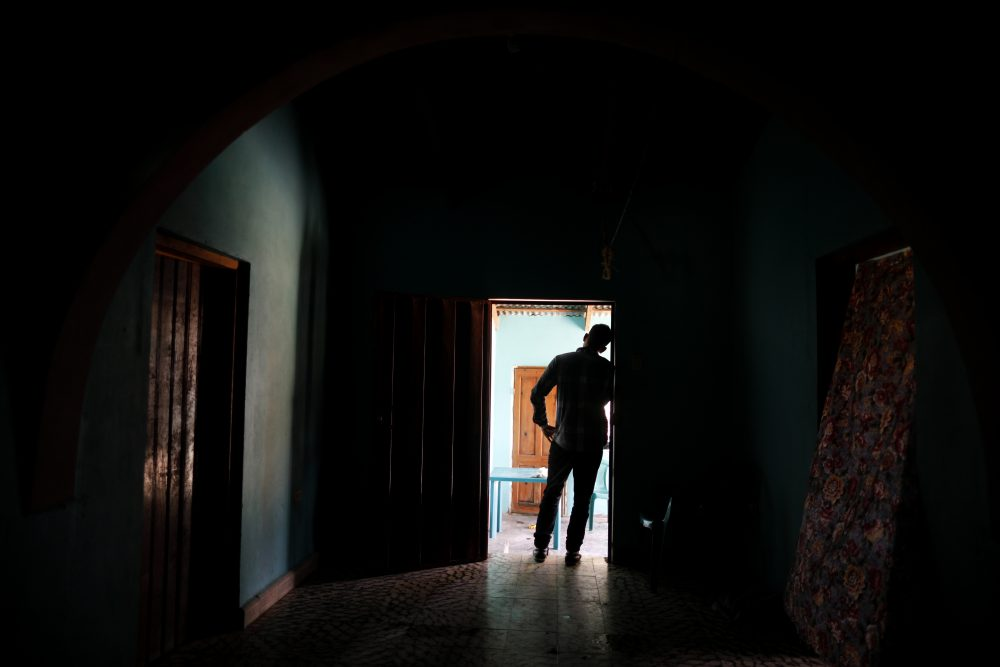 In this Aug. 23, 2019, photo, a Honduran father stands at his home in Comayagua, Honduras, after talking in an interview about being separated from his 3-year-old daughter at the border after traveling for weeks to seek asylum in the U.S. According to court records, his daughter was sexually abused in U.S. foster care. She was later deported and arrived back in Honduras withdrawn, anxious and angry.