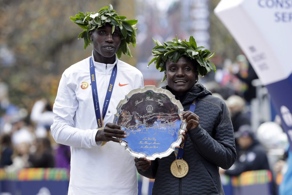Geoffrey Kamworor, left, and Joyciline Jepkosgei, both of Kenya, pose as the men's and women's winners of the New York City Marathon on Sunday  in New York's Central Park.