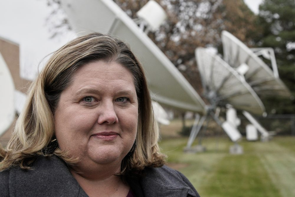 Shannon Booth, vice president and general manager for Gray Television who oversees company-owned Nebraska stations in Lincoln, Hastings and North Platte, poses for a portrait Nov. 21 in front of the KOLN television station's satellite dishes in Lincoln, Neb.