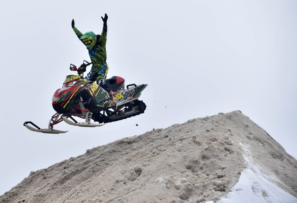 A stunt rider with RaveX performs at the Snodeo in Rangeley in 2017.
