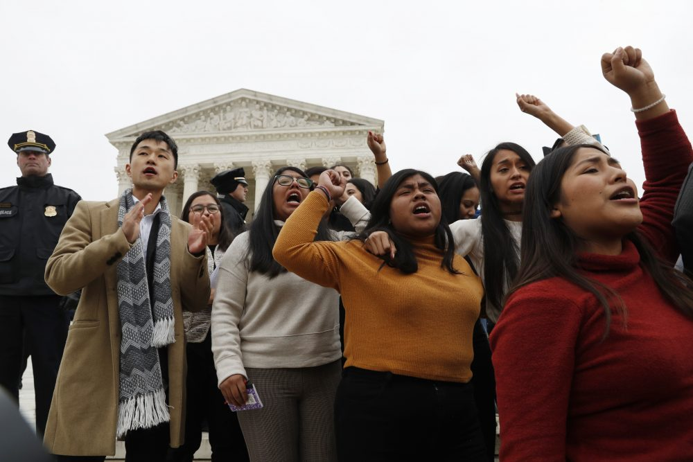 DACA recipients and others leave the U.S. Supreme Court with their hands in the air after oral arguments were heard in the case of President Trump's decision to end the Obama-era Deferred Action for Childhood Arrivals program on Tuesday at the Supreme Court in Washington.