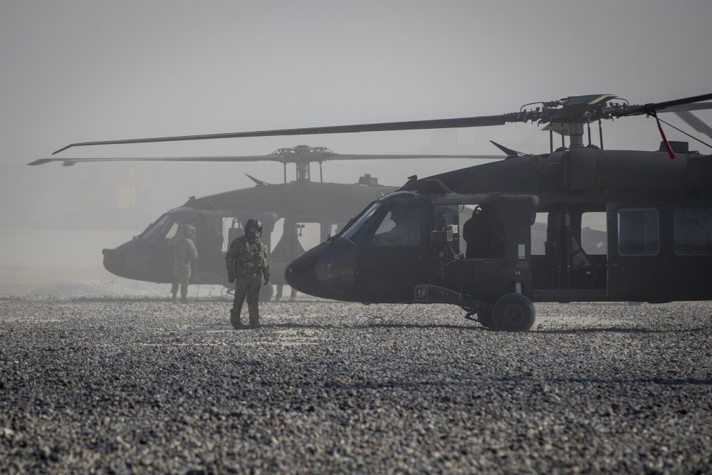 Blackhawk helicopters are parked at a U.S. military base at undisclosed location in Eastern Syria, Monday, Nov. 11, 2019. A senior U.S. coalition commander said Friday, Nov. 15,  the partnership with Syrian Kurdish forces remains strong and focused on fighting the Islamic State group, despite an expanding Turkish incursion on areas of Kurdish control.