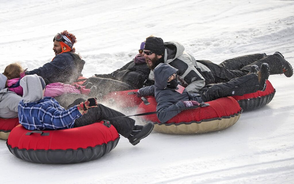 A gaggle of tubers caravan down the hill on the first day Eaton Mountain in Skowhegan was open in 2018: Monday, Dec. 31. The mountain is closed this year as the owners regroup to decide the area's future.