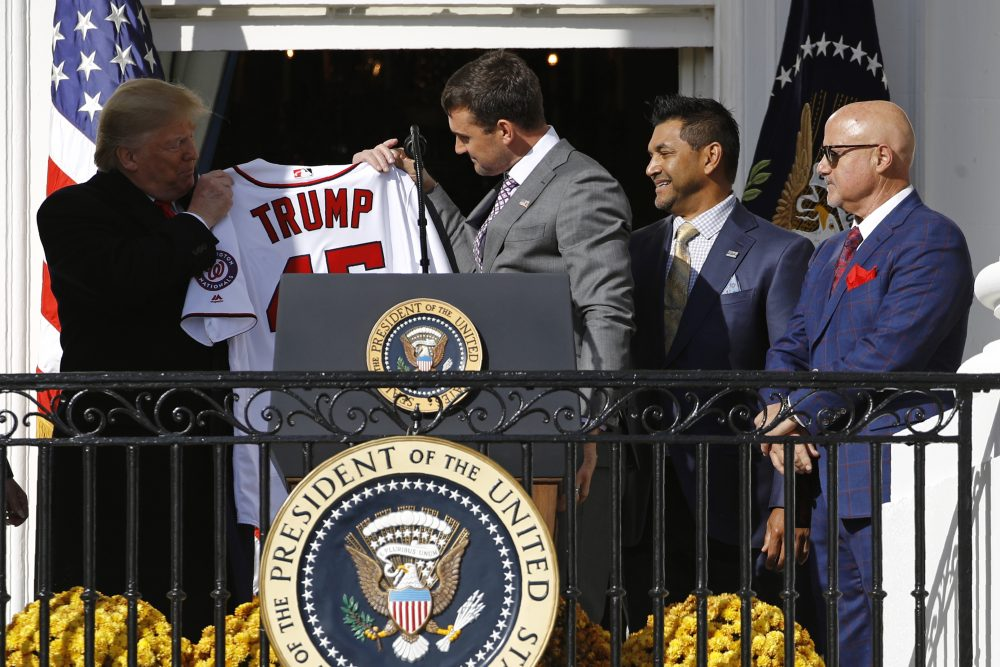Nationals first baseman Ryan Zimmerman, center, presents a jersey to President Trump at the White House on Monday. Standing alongside Zimmerman are manager Dave Martinez, second from right, and General Manager Mike Rizzo.