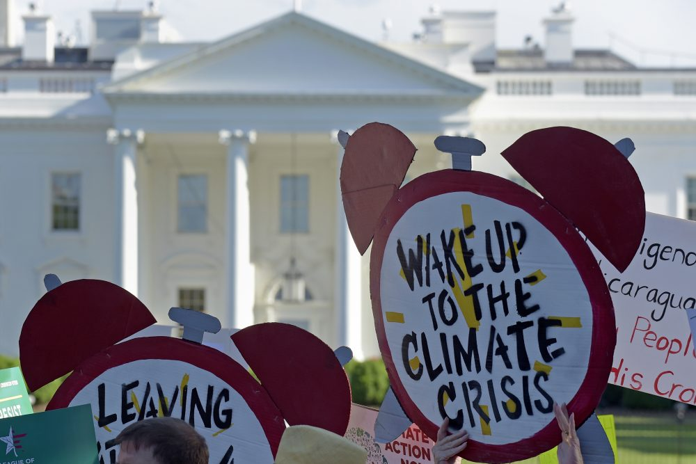 Protesters gather outside the White House in June 2017 to protest President Trump's decision to withdraw the Unites States from the Paris climate change accord. Associated Press/Susan Walsh
