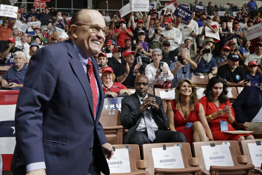 Rudy Giuliani arrives at President Trump's campaign rally Aug. 15 in Manchester, N.H.