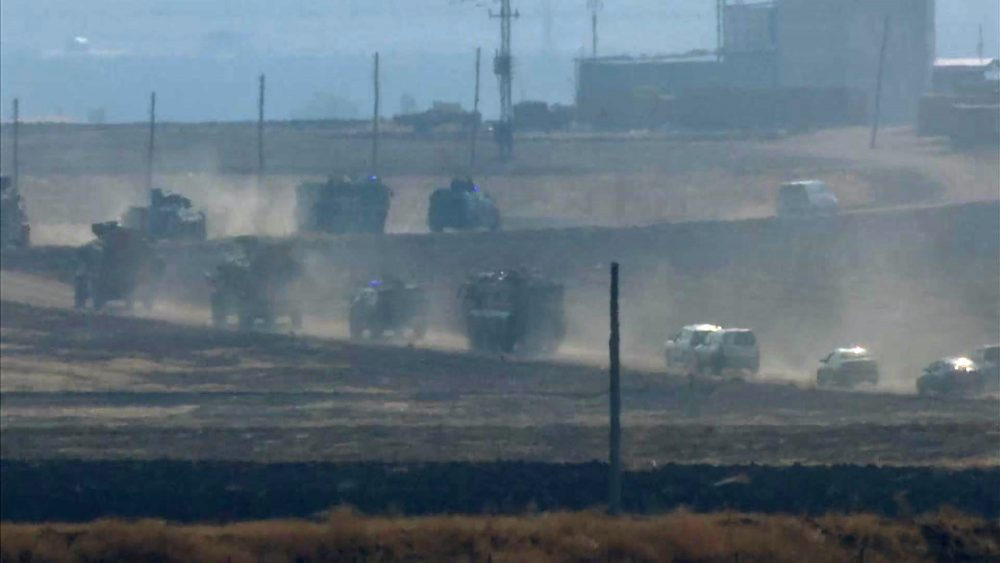 Military vehicles move in convoy along a road in Sevimli, Mardin Province, Turkey on Friday Nov. 1, 2019.  Turkey and Russia launched joint patrols Friday in northeastern Syria, under a deal that halted a Turkish offensive against Syrian Kurdish fighters who were forced to withdraw from the border area following Ankara's incursion.