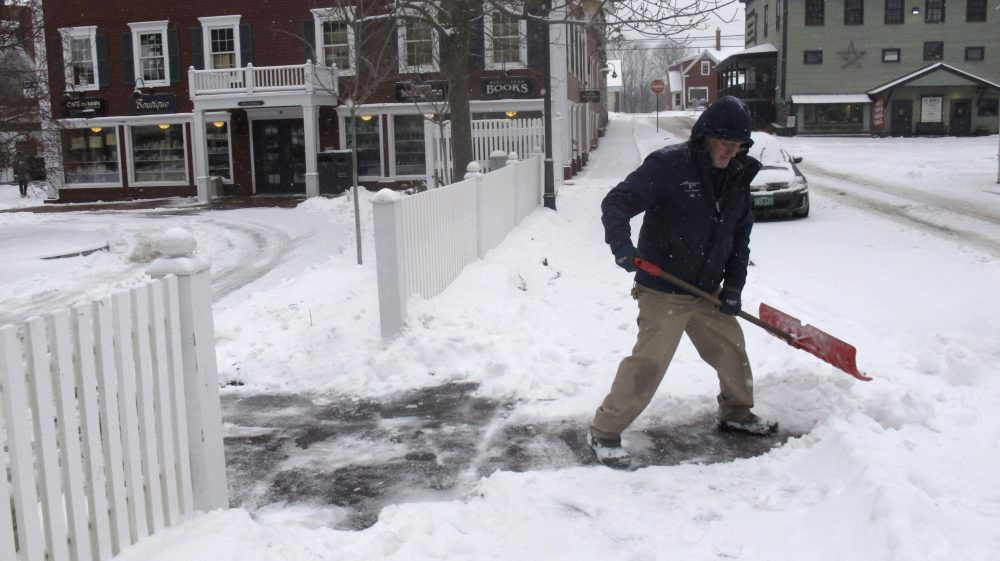 Bill Langley, of the Green Mountain Inn, in Stowe, Vt., shovels snow from a sidewalk on Tuesday.