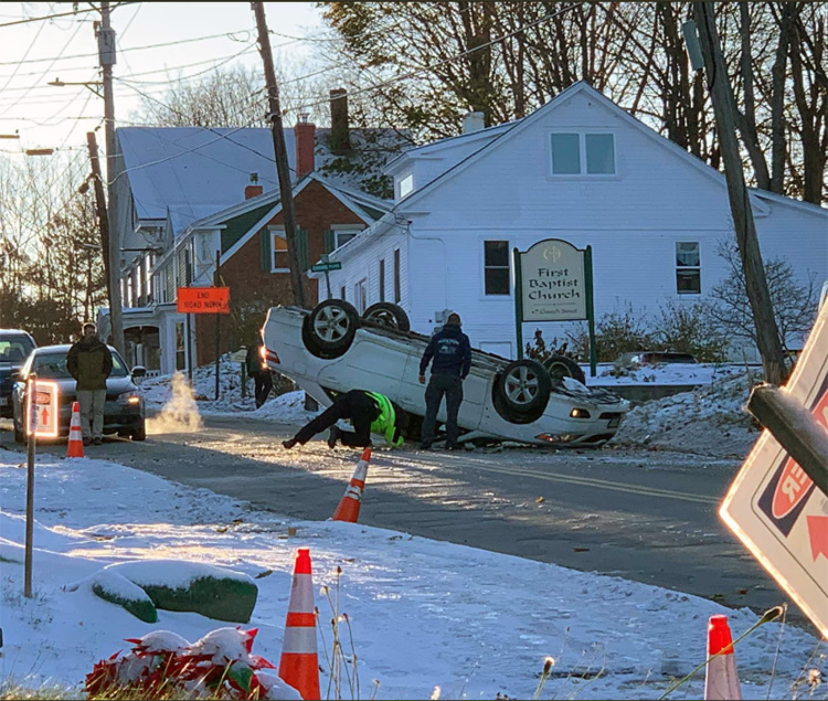 No one was injured Wednesday afternoon when a car driving up the hill on Church Street in Gardiner struck a utility pole and flipped on its roof.