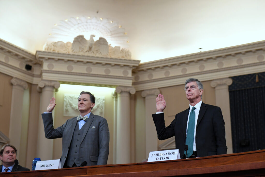 George Kent, left, and William Taylor are sworn in for the House Intelligence Committee impeachment hearing Wednesday on Capitol Hill.
