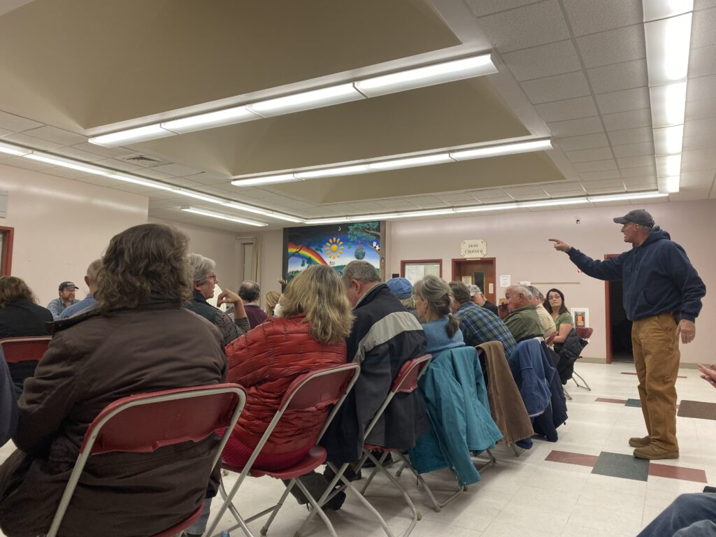 Resident Bruce Hurley confronts First Selectman Vernon Worthen at the Mercer town meeting on Nov. 21, 2019.