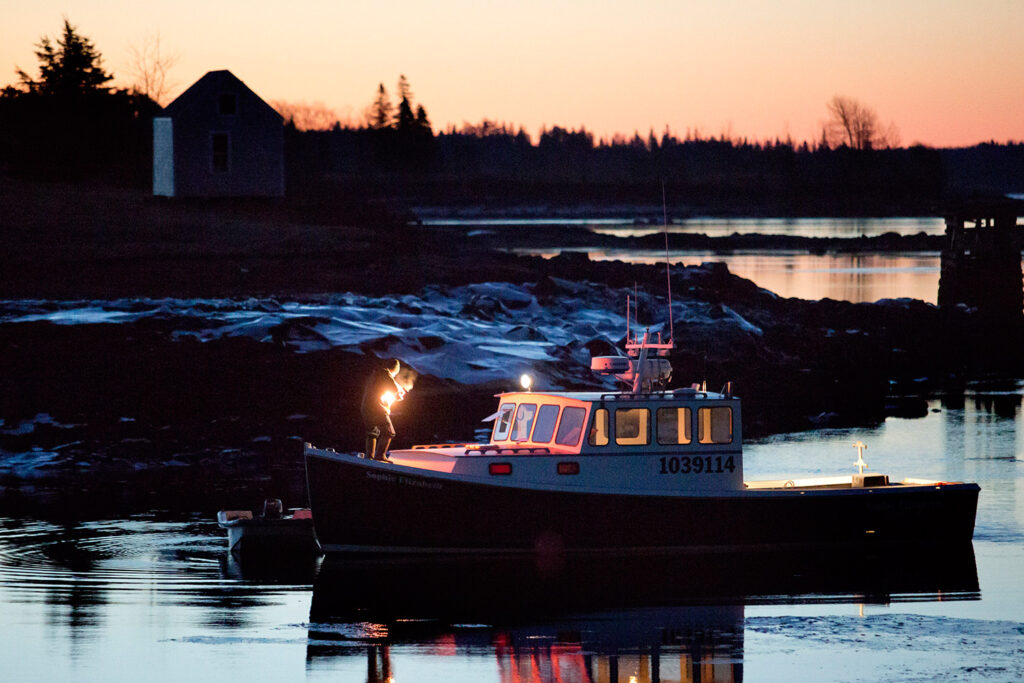 Jamie Sewell of Warren prepares his boat for a scallop diving off the coast of Cushing in January 2015.