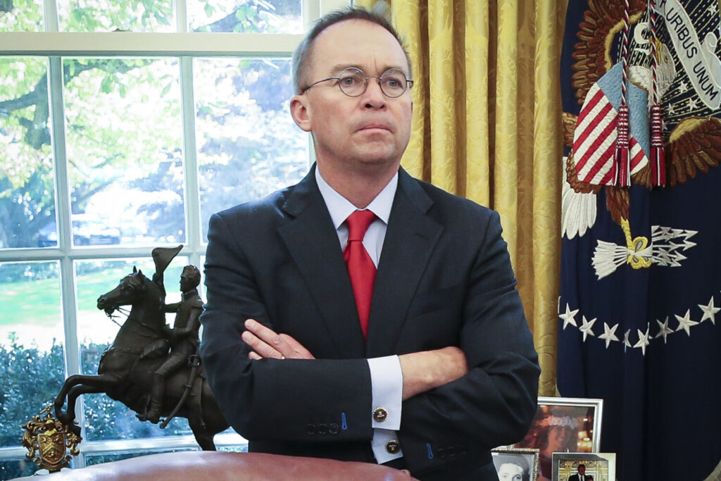 Acting White House chief of staff Mick Mulvaney listens as President Trump speaks during a meeting with Turkish President Recep Tayyip Erdogan in the Oval Office on Nov. 13.