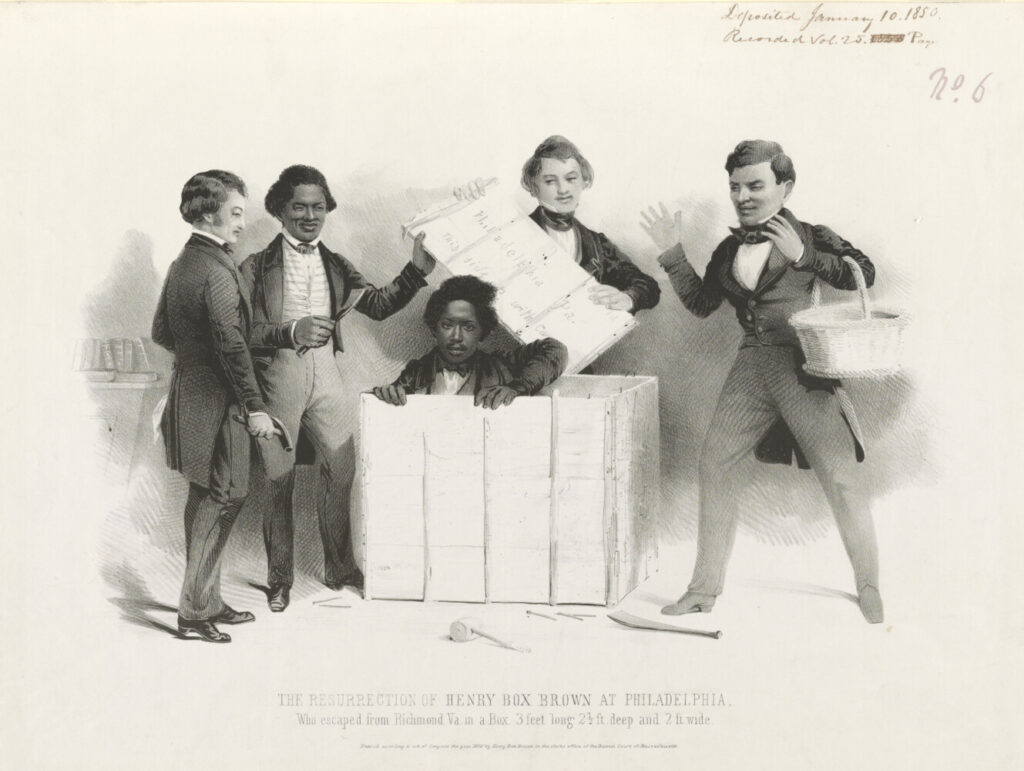 "Henry ""Box"" Brown emerges from a wooden crate after mailing himself to freedom as several people, including abolitionist Frederick Douglass (holding a claw hammer at left) look on."