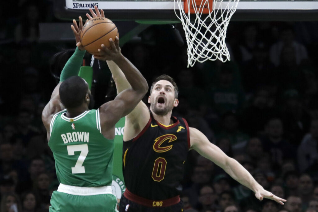 Celtics guard Jaylen Brown shoots against Cavaliers forward Kevin Love during the Celtics' 129-11-7 win on Friday in Boston. Brown finished with 34 points and nine rebounds.