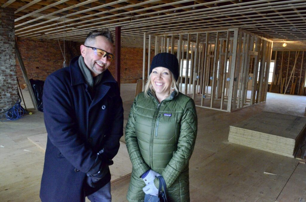Alan Claude, left and Erin Skehan on what will be a studio on the third floor Dec. 5 in Dingley Block on Water Street in Gardiner.