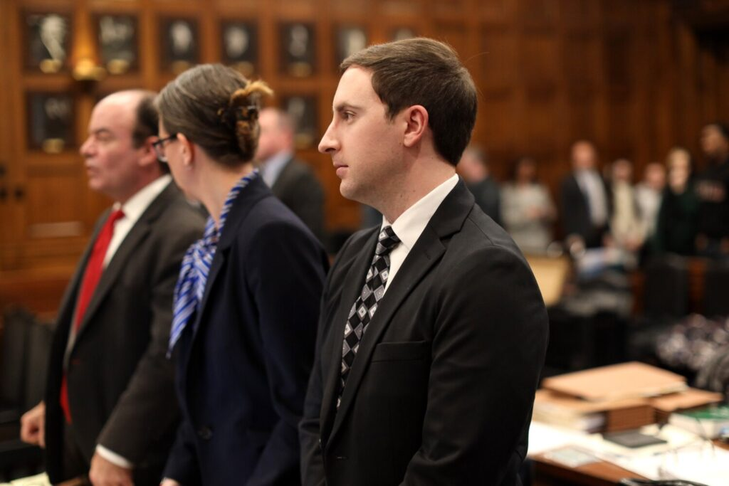 Mark Cardilli Jr. stands with his attorneys Monday as Justice Nancy Mills leaves the courtroom on the first day of his trial at the Cumberland County Courthouse. Cardilli is charged with murder in the death of Isahak Muse, who was Cardilli's younger sister's boyfriend.