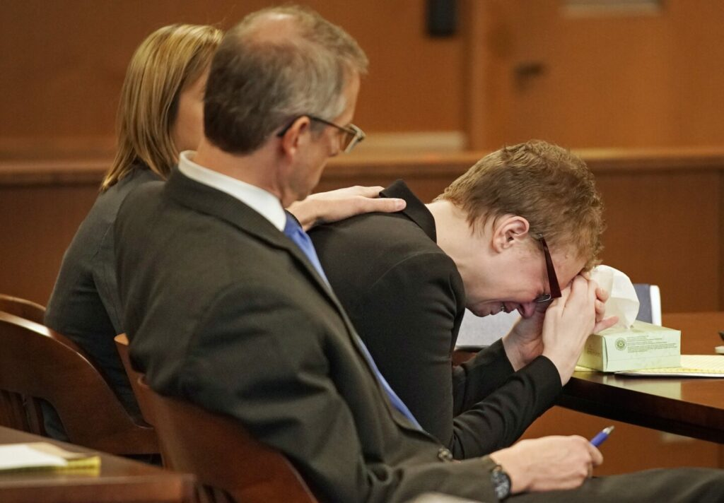 Sharon Carrillo puts her head in her hands and cries while Assistant Attorney General Donald Macomber delivers his opening statement Friday in Carrillo's trial. Carrillo is charged with depraved indifference murder in the 2018 death of her 10-year-old daughter, Marissa Kennedy. With Carrillo are her attorneys, Laura Shaw and Christopher MacLean.