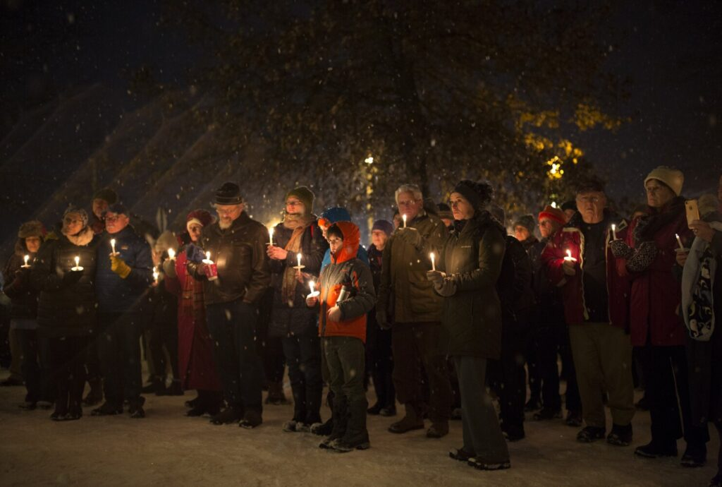 Friends, family and community members gather at a candlelight vigil Friday evening at the Brunswick mall for Anneliese Heinig, a mother of two who hasn't been seen since Nov. 26.