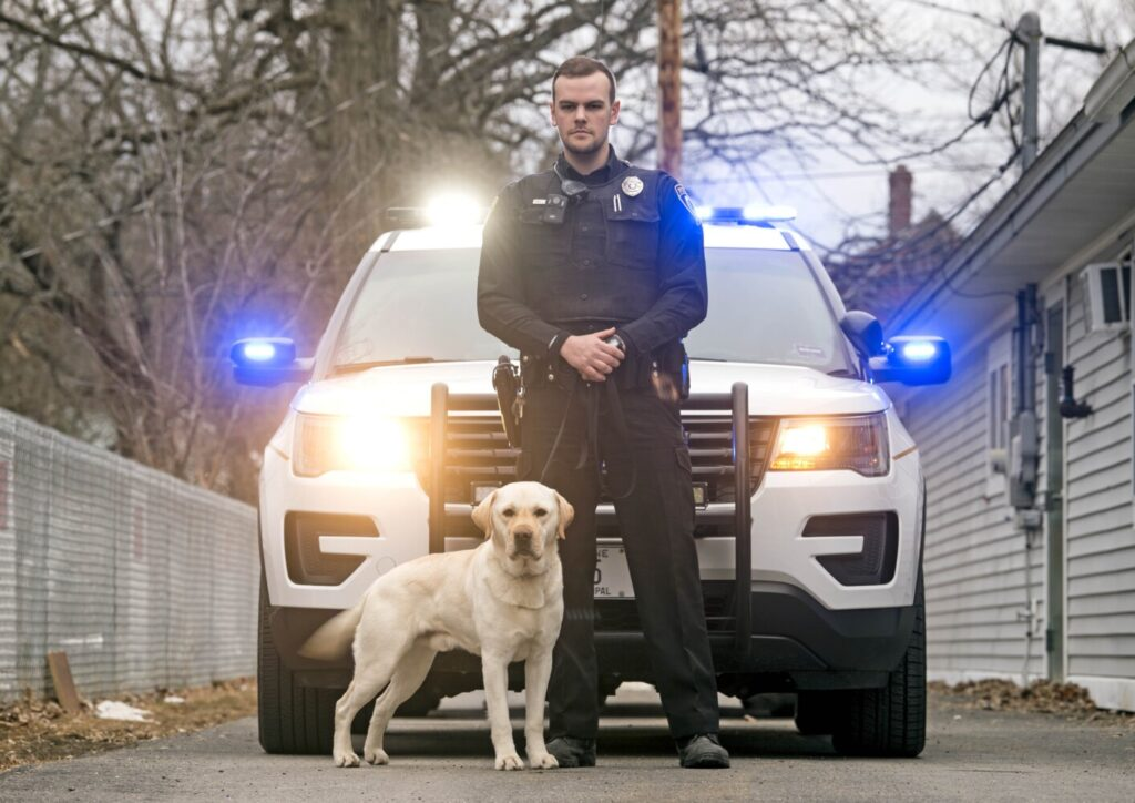 Jimmy Leathers poses for a portrait Friday with his new K-9 companion, Wrex, outside the Clinton Police Department.