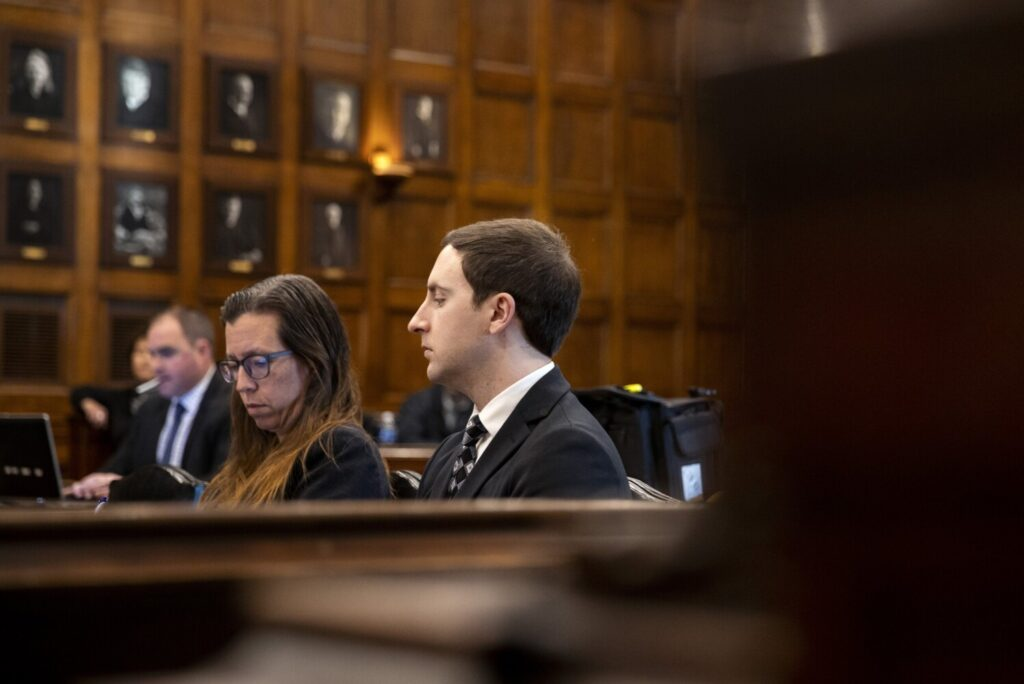 Mark Cardilli Jr. sits in court Thursday as his attorney Matt Nichols questions one of the defense's witnesses in Cardilli's murder trial.